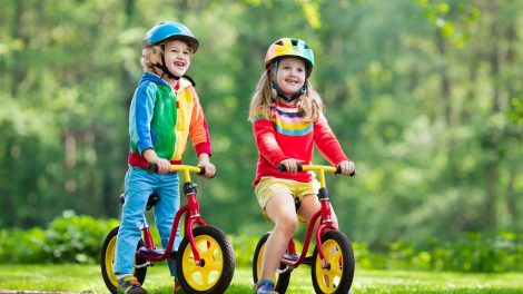 kids ride bike in a park - kids ride wild