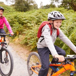 two children biking